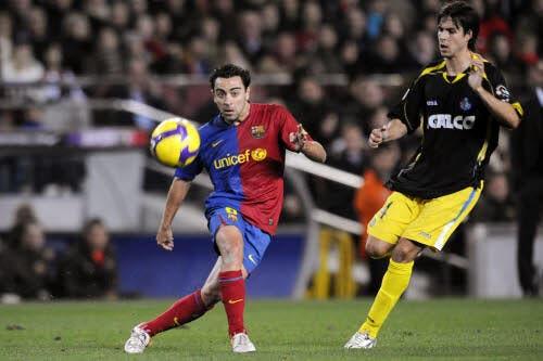 Xavi prolonge au Barça